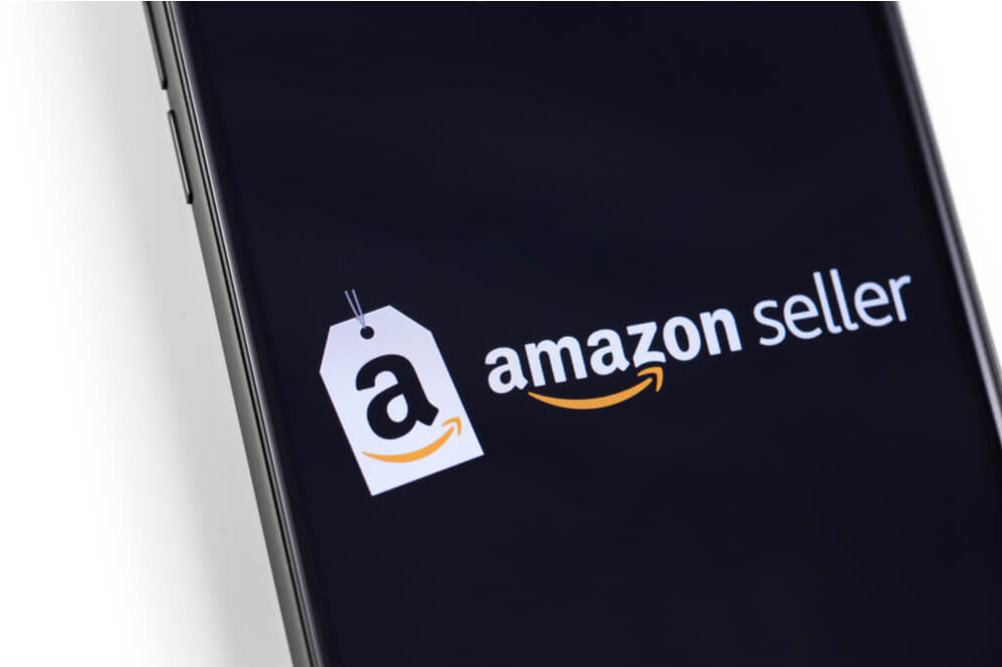 An Amazon app logo is shown on a smartphone
