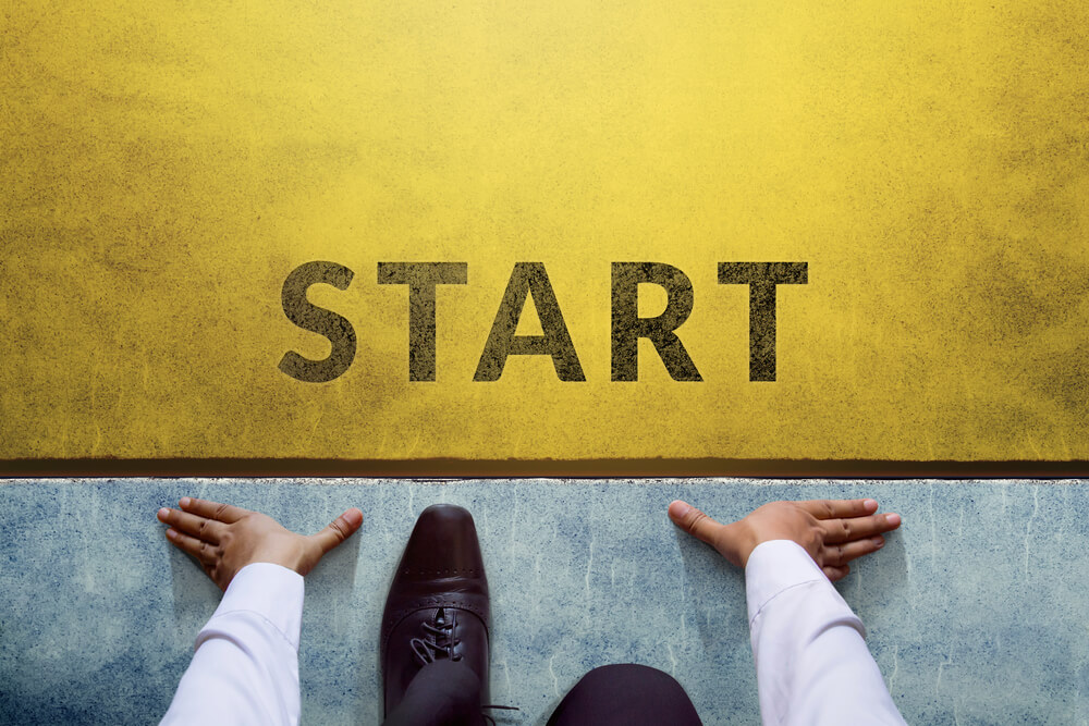 A businessman is on the starting line