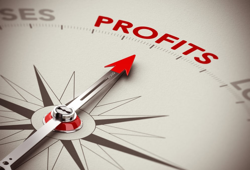 A compass that points to the word Profits